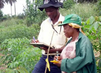 Picture of Field scientist and woman farmer in the field